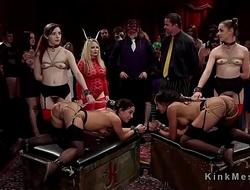 Group of hot slaves serving at kink ball