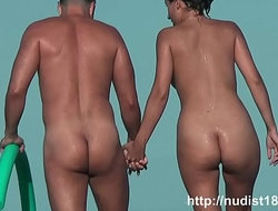 Nudist beach voyeur vid with two gorgeous brunettes all naked